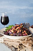 Warm salad with beans, potatoes and roasted beetroot