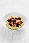 Creamy millet porridge with berries and nuts