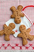 Three gingerbread men on a fabric bag
