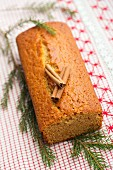 Gingerbread cake with cinnamon sticks and a pine sprig
