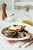 Walnut and pear salad with grilled bread topped with melted cheese