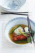 Broth with rice noodles, salmon and asparagus (Asia)