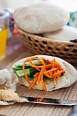 Pita bread stuffed with carrots and cucumber