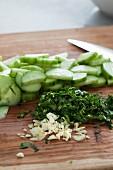 Sliced cucumber, fresh parsley and garlic for a salad