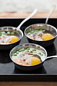 Oeufs en cocotte with mushrooms and peas
