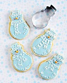 Snowman shaped Christmas biscuits with blue and white icing
