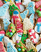 A selection of Christmas biscuits decorated with icing sugar
