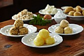 Bread dumpling, potato dumplings and quark dumplings with ingredients