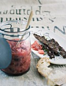 Rhubarb chutney with venison skewers on a piece of course linen