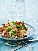 Pork stew with tomatoes, onions, mushrooms, cream and curry served with rice