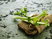 Celery sticks on a hessian sack