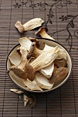 A bowl of dried king trumpet mushrooms