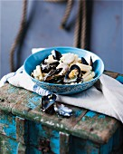 Pasta with hake and mussels in a creamy sauce