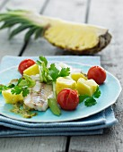 Fish fillet with pineapple and cherry tomatoes