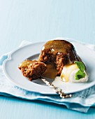 Gingerbread pudding with ginger ale and brandy sauce