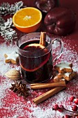 Mulled wine with a slice of orange and a cinnamon stick (Christmas)