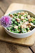 Pea salad with spicy tofu, soya yoghurt, chives and mint