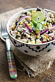 Couscous salad with black beans, sweetcorn, coriander, red onions and jalapeños (Central America)