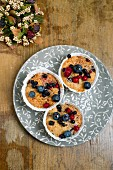 Berry muffins with blueberry syrup