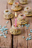 Mini vanilla marble cakes with a lighted candle