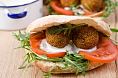 Unleavened bread filled with falafel, tomatoes and rocket