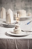 A coconut cake with a sparkler