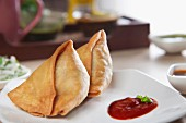 Samosas with tomato ketchup