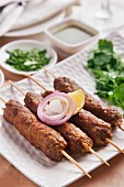 Seekh kebab with onion and lemon (meat skewers, India)