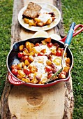 Fried potatoes with chorizo, tomatoes and fried egg