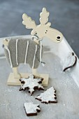 Chocolate confectionery with coconut flakes and a wooden moose figurine for Christmas