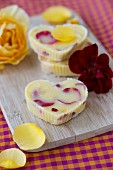 Heart-shaped rose butter and rose petals on a chopping board