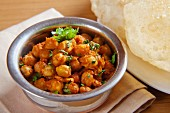 Chole bhatura (spicy chickpeas with fried bread, India)