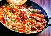 Chicken biryani in a large pan