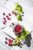 Homemade raspberry jam and raspberries