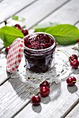 A jar of cherry jam and sour cherries