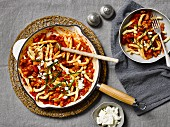 Pasta with tomato sauce, spicy sausage and feta cheese