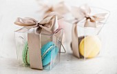 Macaroons in transparent gift boxes