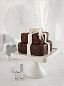 A chocolate wedding cake with a fondant bow