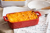 Shepherd's Pie in a baking dish on top of a handwritten recipe