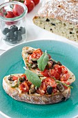 Bruschetta with tomatoes, olives and sage