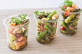 Three glasses of asparagus salad with crayfish