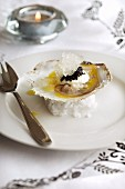 An oyster with caviar and ice
