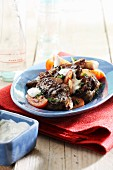 Beef with tomatoes and yoghurt sauce