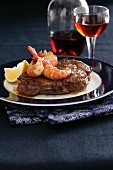 Beef steak with prawns