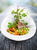 Lamb chops with diced vegetables and chervil