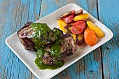 Grilled lamb chops with mint chimichurri and carrots