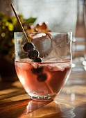 Blueberry and vodka cocktail with a blueberry skewer