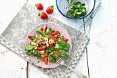 Asparagus salad with strawberries and lamb's lettuce