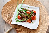 Beef teriyaki with tomatoes, mange tout and onions (Japan)