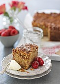 Apple cake with cream and fresh raspberries